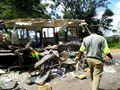A policeman inspects Wreckage of ZUPCO bus after an accident with Unifreight bus on 18 January 2015.jpg